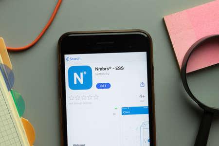 New York, USA - 26 October 2020: Nmbrs ESS mobile app logo on phone screen close up, Illustrative Editorial. Sajtókép