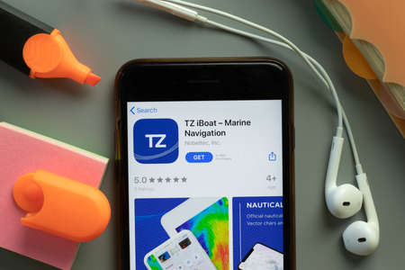 New York, USA - 1 December 2020: TZ iBoat mobile app icon on phone screen top view, Illustrative Editorial.
