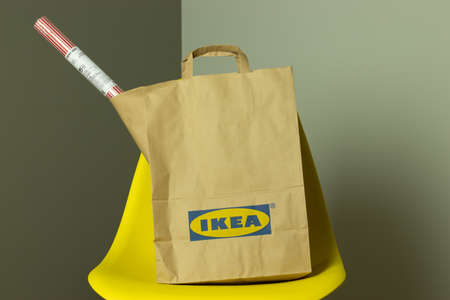 Moscow, Russia - 5 December 2020: IKEA package with goods, paper bag with IKEA logo, Illustrative Editorial.
