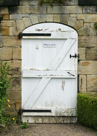 locked the door locked: Old White Wooden Door To Walled Garden Stock Photo