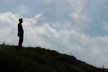 Silhouette of a man on a hill photo