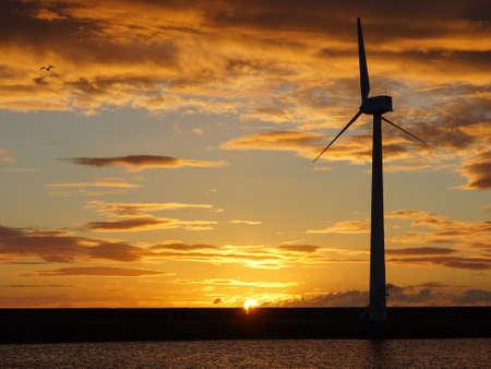 wind turbine: coastal wind turbine at daybreak Stock Photo