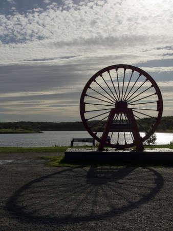 Shaft Head Wheel Mining Monument At Sunset photo