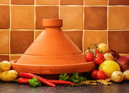 Plain Clay Moroccan Tagine With Vegetables photo