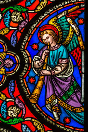 Stained Glass Window Of An Angel With A Trumpet