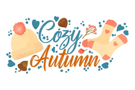 Cozy Autumn - Fall typography quotes with autumns elements. Vector quotes with autumns knitted socks, forest nuts, berries and knitted hat with pompon. Isolated on white background.