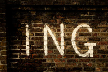 Old brick wall with the word ING written on it