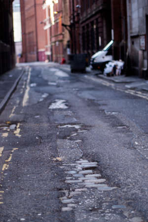 Cracked ground in a street in Manchester