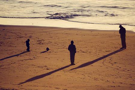 Orange sunset on a nice blue beach in the coast of Morocco Foto de archivo