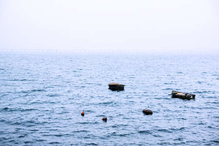 View of some fisher boats in a foggy day