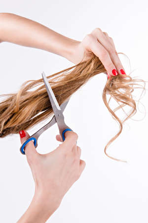 the ends: girl cuts her split ends of hair