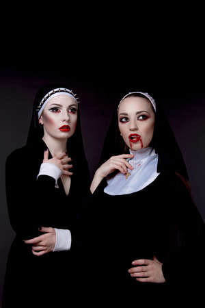 sexy devil: Halloween. The girls are dressed in sexy evil nuns Stock Photo