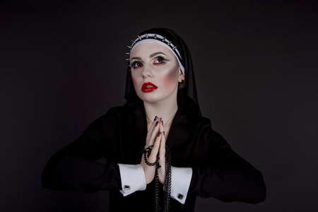 plea: Halloween. Girl dressed in evil sexy nun