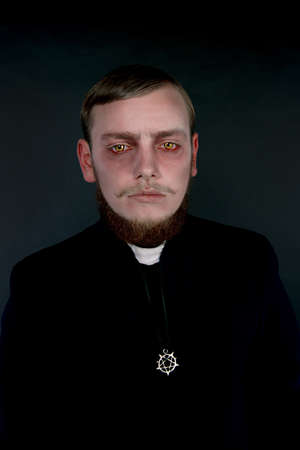 Halloween. A man dressed as the evil Catholic priest Stock Photo