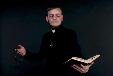 demoniacal: Halloween. A man dressed as the evil Catholic priest Stock Photo