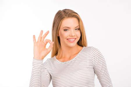 cheerful girl showing gesture ok