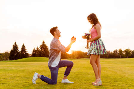 box love: young man makes a proposal of betrothal to his girlfriend