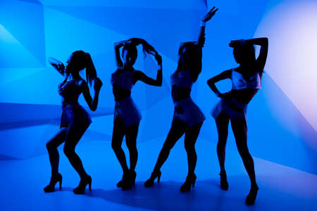 silhouettes of dancing girls Stock Photo