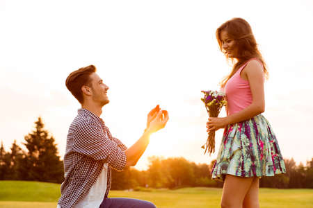 young man makes a proposal of betrothal to his girlfriend Stock Photo - 44653376