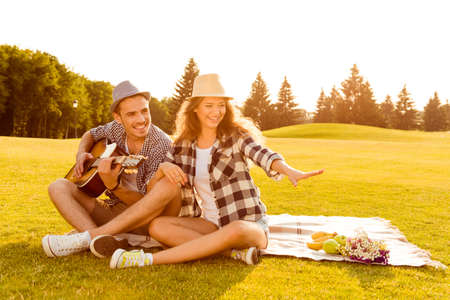 family on grass: happy couple in love at a picnic
