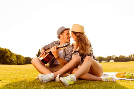 love story: happy couple in love at a picnic