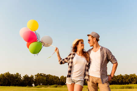 sunglass: couple in love walking with balloons Stock Photo