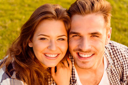 young man smiling: happy young couple in love smiling Stock Photo