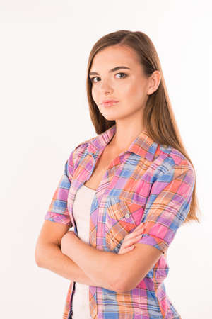 arms crossed: calm and confident young woman in shirt