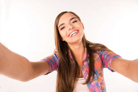 sexy photo: young woman making selfie photo and smiling
