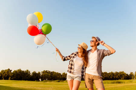 love story: couple in love walking with balloons Stock Photo