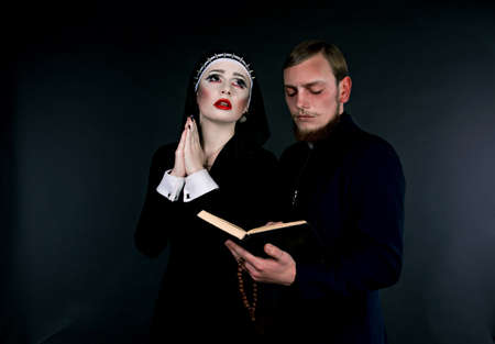 demoniacal: Halloween. A man and woman dressed as the clergy Stock Photo