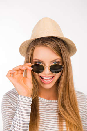 girl with a hat pulled the glasses on her nose Stock fotó