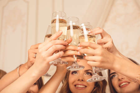 Cheers! girls celebrate a bachelorette party of bride. Stock Photo