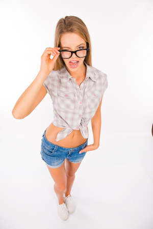young sexy woman with glasses showing her tongue