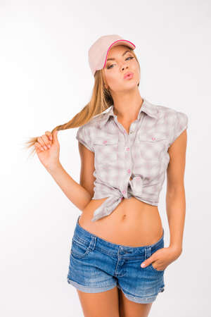 pouting: sexy and cute girl with cap pouting lips Stock Photo