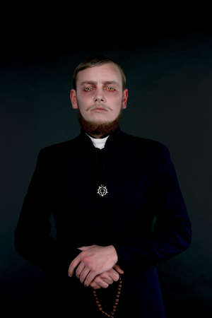 succubus: Halloween. A man dressed as the evil Catholic priest Stock Photo