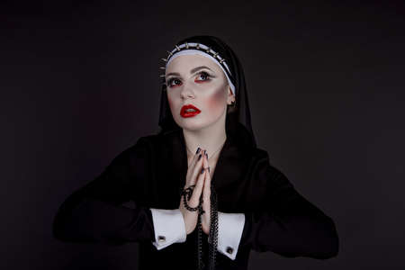 incubus: Halloween. Girl dressed in evil sexy nun