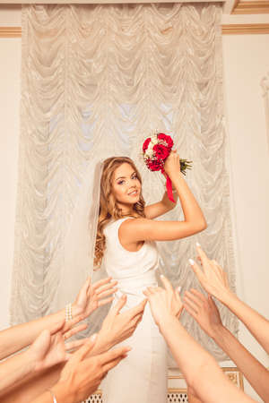 girls night out: cute bride throws her bouquet.