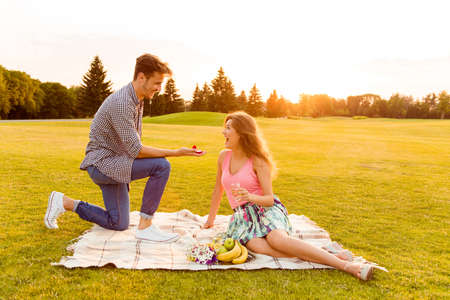 betrothal: young man makes a proposal of betrothal to his girlfriend