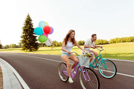 funny guys: happy couple together to ride a bicycle