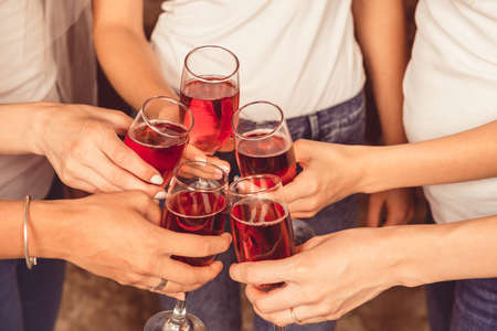 clink: cheers! girls clink glasses of champagne Stock Photo