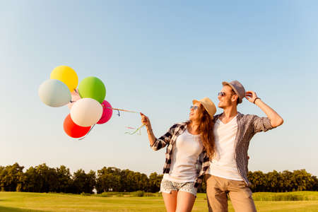 two story: couple in love walking with balloons Stock Photo