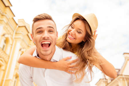 friends fun: Happy young man piggybacking his beloved Stock Photo