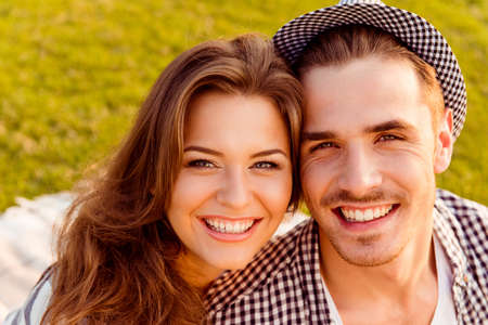 toothy smiles: happy couple in love at a picnic