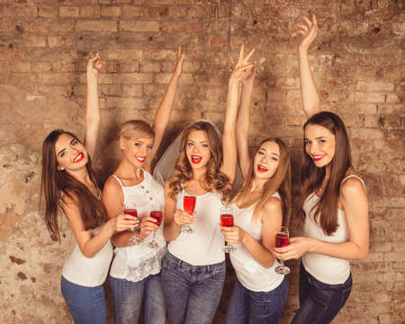 veil: girls celebrate a bachelorette party of bride.