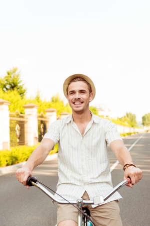 funny guys: Happy young man in hat riding a bicycle