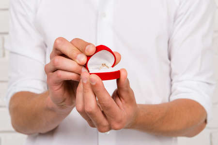 marriage: romantic man making a marriage proposal