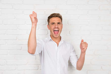 successfully: Happy man reaches the goal successfully