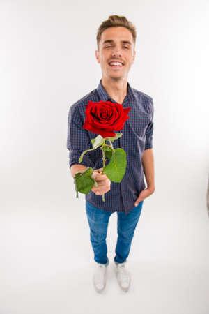 hombre romantico: top view of romantic man gives a red rose Foto de archivo