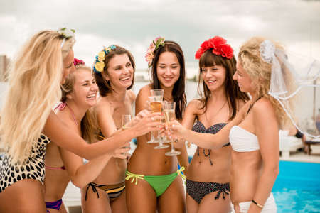 girl party: happy girls on the beach. Stock Photo